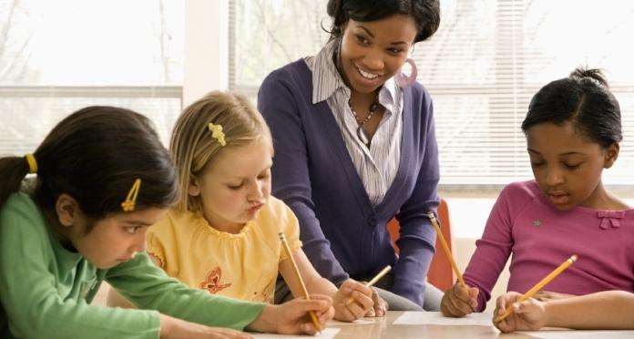teacher-helping-students-math-rigor-703914-edited.jpg