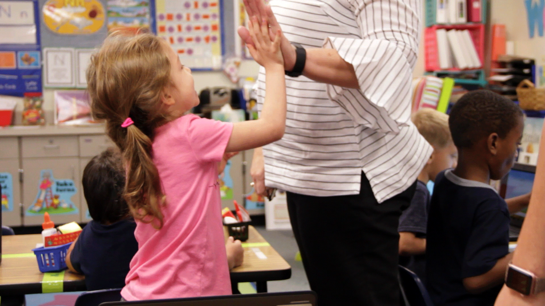 brazosport-girl-teacher-high-five