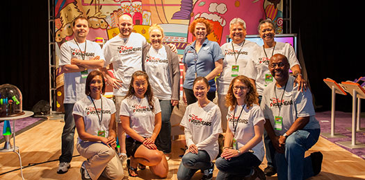 Photo of group of volunteers with Math Fair shirts.